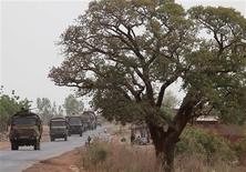 A convoy of French military vehicles heads toward Sevare in the village of Somadougou January 25, 2013. REUTERS/Eric Gaillard