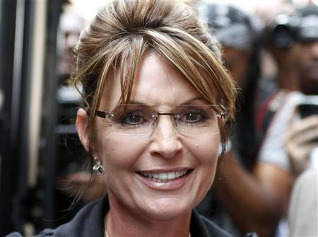 Sarah Palin, former governor of Alaska, walks to her ''One Nation Tour'' bus after a visit to Fox News headquarters in New York, June 1, 2011. REUTERS/Gary Hershorn