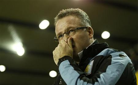 Aston Villa manager Paul Lambert reacts during their FA Cup fourth round soccer match against Millwall at The Den in London January 25, 2013. REUTERS/Eddie Keogh