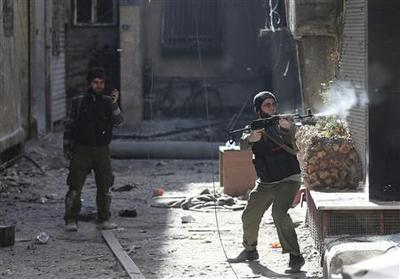 Syrian troops and militia push to take Sunni Homs...