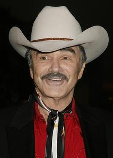 Actor Burt Reynolds arrives as a guest at the Golden Boot Awards in Beverly Hills, California in this August 12, 2006 file photo. REUTERS/Fred Prouser/Files