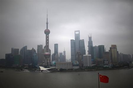 The Bund on the banks of the Huangpu River is pictured on a hazy day in Shanghai, September 8, 2012. REUTERS/Aly Song