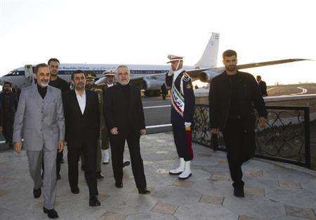Iran's President Mahmoud Ahmadinejad (C), First Vice President Mohammad Reza Rahimi (2nd R) and Ali Akbar Velayati, senior advisor to Ayatollah Ali Khamenei (L) walk at Tehran's Mehrabad airport after Ahmadinejad's visit to Latin American countries, January 14, 2012. REUTERS/Raheb Homavandi