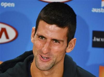 Novak Djokovic of Serbia speaks during a news conference at the Australian Open tennis tournament in Melbourne January 26, 2013. REUTERS/Toby Melville