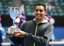 Nick Kyrgios of Australia poses with the trophy after defeating compatriot Thanasi Kokkinakis in their junior boys' singles final match at the Australian Open tennis tournament in Melbourne January 26, 2013. REUTERS/Daniel Munoz