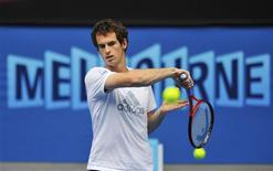 Andy Murray of Britain hits a return during a practice session at the Australian Open tennis tournament in Melbourne January 26, 2013. Murray will play against Novak Djokovic of Serbia in the men's singles final match on Sunday. REUTERS/Toby Melville