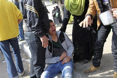 People react after hearing the final verdict of the 2012 Port Said massacre, in Port Said, January 26, 2013. REUTERS/Asmaa Waguih