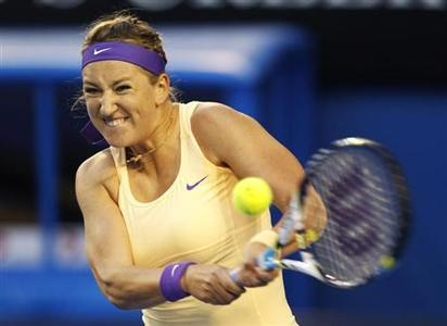 Victoria Azarenka of Belarus hits a return to Li Na of China during their women's singles final match at the Australian Open tennis tournament in Melbourne, January 26, 2013. REUTERS/Daniel Munoz