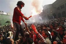 "Al Ahly fans, known as ""Ultras"", celebrate and shout slogans in front of the Al Ahly club after hearing the final verdict of the 2012 Port Said massacre in Cairo January 26, 2013. An Egyptian court on Saturday sentenced to death 21 people found guilty of involvement in the Port Said soccer stadium disaster in which 74 people died last year. Seventy-three people have been charged with involvement in the February 1, 2012 disaster at the end of a match between Cairo's Al Ahly and al-Masry, the local side. REUTERS/Mohamed Abd El Ghany (EGYPT - Tags: POLITICS CIVIL UNREST SPORT SOCCER CRIME LAW) - RTR3CZ53"