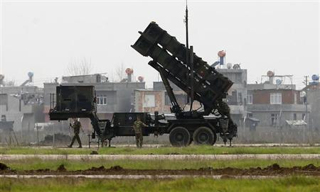 Dutch soldiers get ready for a media day as they stand next to the Patriot missile system at a military airbase in Adana, southern Turkey, January 26, 2013. REUTERS/Murad Sezer