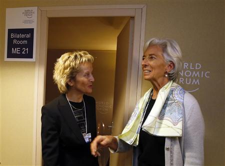 Swiss Finance Minister Eveline Widmer-Schlumpf (L) chats with International Monetary Fund (IMF) chief Christine Lagarde during the annual meeting of the World Economic Forum (WEF) in Davos January 26, 2013. REUTERS/Pascal Lauener