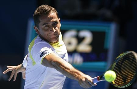 Nicolas Almagro of Spain hits a return to compatriot David Ferrer during their men's singles quarter-final match at the Australian Open tennis tournament in Melbourne January 22, 2013. REUTERS/Damir Sagolj