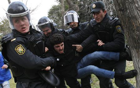 Policemen detain a man, who was protesting in solidarity with Ismailli residents after Thursday's riot, in Baku January 26, 2013. REUTERS/David Mdzinarishvili