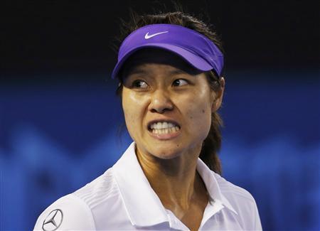 Li Na of China reacts during her women's singles final match against Victoria Azarenka of Belarus at the Australian Open tennis tournament in Melbourne January 26, 2013. REUTERS/Damir Sagolj