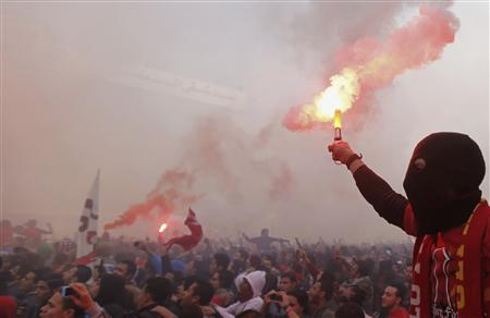 Al Ahly fans, also known as ''Ultras'', celebrate and shout slogans in front of the Al Ahly club after hearing the final verdict of the 2012 Port Said massacre in Cairo January 26, 2013. REUTERS/Amr Abdallah Dalsh