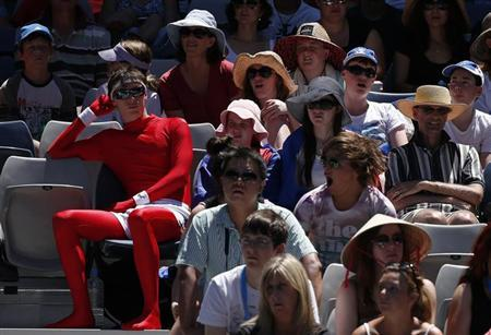 Fans watch the women's singles match between Li Na of China and Olga Govortsova of Belarus at the Australian Open tennis tournament in Melbourne, January 16, 2013. REUTERS/David Gray