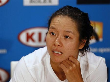 Li Na of China attends a news conference after being defeated by Victoria Azarenka of Belarus in their women's singles final match at the Australian Open tennis tournament in Melbourne, January 26, 2013. REUTERS/Navesh Chitrakar