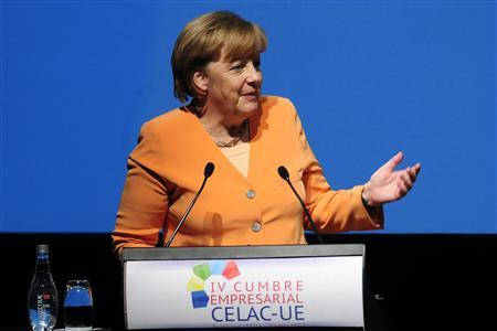 German Chancellor Angela Merkel delivers a speech at the 4th business summit of the Community of Latin American, Caribbean States and European Union (CELAC-UE) in Santiago, January 26, 2013. REUTERS/Jorge Sanchez