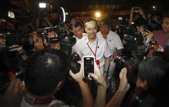 People's Action Party candidate Koh Poh Koon arrives at the poll counting center during the Punggol East by-election in Singapore January 26, 2013. REUTERS/Edgar Su