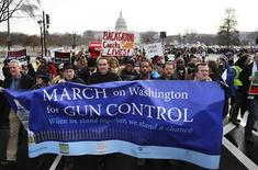 Washington DC Mayor Vincent Gray (4th L) helps lead the March on Washington for Gun Control on the National Mall in Washington, January 26, 2013. REUTERS/Jonathan Ernst