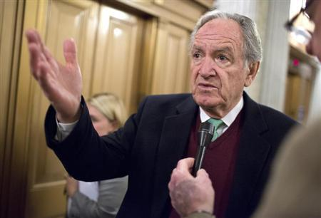Senator Tom Harkin (D-IA) speaks to reporters after a vote on Capitol Hill in Washington December 17, 2012. REUTERS/Joshua Roberts
