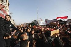 Residents carry a coffin during the funeral of a victim killed in clashes with security forces in Falluja, 50 km (30 miles) west of Baghdad, January 26, 2013. REUTERS/Thaier Al-Sudani