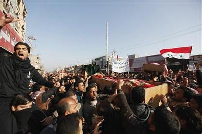 Iraqi Sunnis mourn protesters shot dead by troops