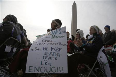 People hold a sign against gun violence as they participate in the March on Washington for Gun Control on the National Mall in Washington, January 26, 2013. REUTERS/Jonathan Ernst