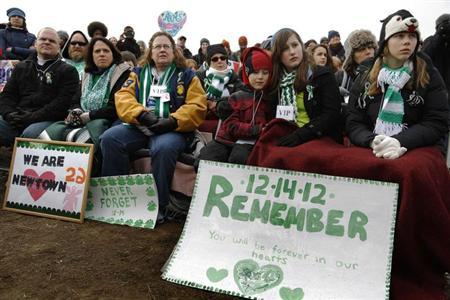 Participants from Newtown, Connecticut, wearing the green and white colors of Sandy Hook Elementary School where 26 children and adults were killed in a mass shooting in December, sit in the front rows during the March on Washington for Gun Control on the National Mall in Washington, January 26, 2013. REUTERS/Jonathan Ernst