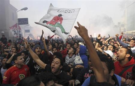 Al Ahly fans, also known as ''Ultras'', celebrate and shout slogans inside Al Ahly club's training stadium after hearing the final verdict of the 2012 Port Said massacre, in Cairo January 26, 2013. REUTERS/Amr Abdallah