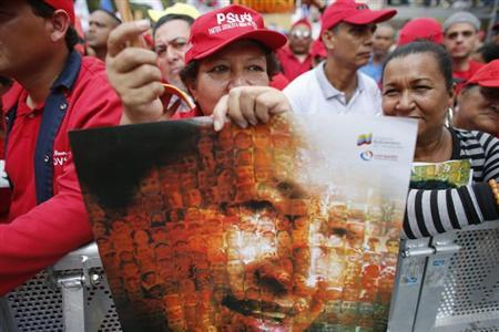 Supporters of Venezuela's President Hugo Chavez attend a rally to commemorate the 55th anniversary of the last Venezuelan dictatorship collapse, in Caracas January 23, 2013. REUTERS/Jorge Silva