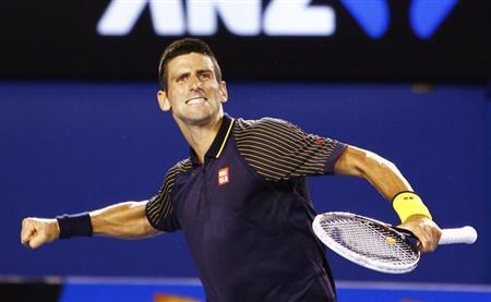 Novak Djokovic of Serbia celebrates defeating David Ferrer of Spain in their men's singles semi-final match at the Australian Open tennis tournament in Melbourne January 24, 2013. REUTERS/Navesh Chitrakar
