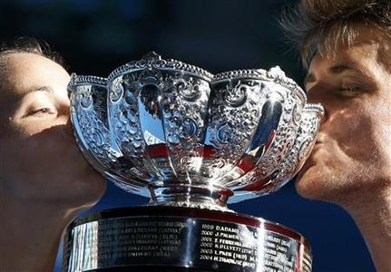 Jarmila Gajdosova and Matthew Ebden (R) of Australia kiss the trophy after defeating Lucie Hradecka and Frantisek Cermak of Czech Republic in their mixed doubles final match at the Australian Open tennis tournament in Melbourne January 27, 2013. REUTERS/Damir Sagolj