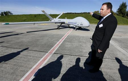 Elad Aharonson, General Manager and Chief Executive Officer UAS Division at Israel's Elbit Systems Ltd. speaks next to the Elbit Hermes 900 unmanned aerial vehicle (UAV) during a media presentation at the airbase in the central Swiss town of Emmen October 16, 2012. REUTERS/Pascal Lauener