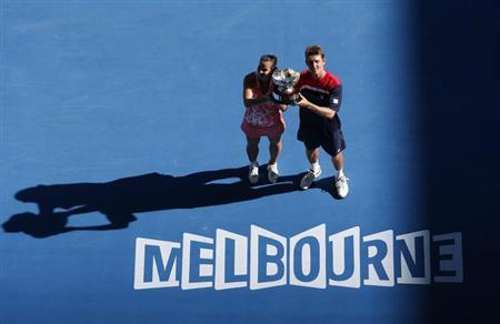 Jarmila Gajdosova and Matthew Ebden (R) of Australia pose with the trophy after defeating Lucie Hradecka and Frantisek Cermak of Czech Republic in their mixed doubles final match at the Australian Open tennis tournament in Melbourne January 27, 2013. REUTERS/David Gray