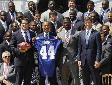 U.S. President Barack Obama (front row, 2nd L) honors the New York Giants NFL team, winners of Super Bowl XLVI, during a ceremony on the South Lawn of the White House in Washington June 8, 2012. REUTERS/Jason Reed