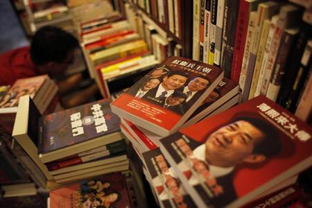 Books on the arrested Chinese official Bo Xilai (R) and potential new Chinese leaders are displayed inside a bookstore in Hong Kong, which sells books that banned in mainland China, November 6, 2012. REUTERS/Bobby Yip/Files