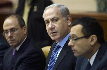 Israel's Prime Minister Benjamin Netanyahu, Vice Prime Minister Silvan Shalom (L) and Cabinet Secretary Zvi Hauser (R) attend the weekly cabinet meeting in Jerusalem June 27, 2010. REUTERS/Dan Balilty/Pool