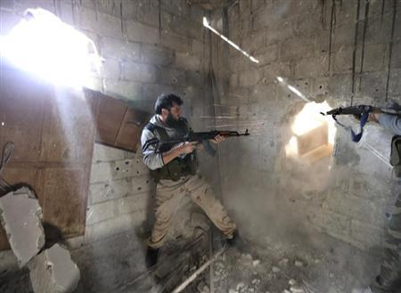 Fighters from the Free Syrian Army's Tahrir al Sham brigade fire back at Syrian army during heavy fighting in Mleha suburb of Damascus January 26, 2013. REUTERS/Goran Tomasevic