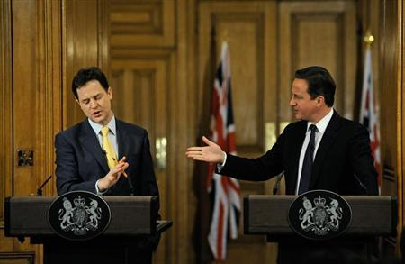 Britain's Prime Minister David Cameron (R) gestures to Deputy Prime Minister Nick Clegg during their joint news conference at number 10 Downing Street in London December 21, 2010. REUTERS/Carl De Souza/Pool