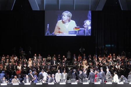 Germany's Chancellor Angela Merkel is seen in a screen during the opening ceremony of the summit of the Community of Latin American, Caribbean States and European Union (CELAC-UE) in Santiago, January 26, 2013. REUTERS/Summit Press/Handout THIS IMAGE HAS BEEN SUPPLIED BY A THIRD PARTY. IT IS DISTRIBUTED, EXACTLY AS RECEIVED BY REUTERS, AS A SERVICE TO CLIENTS. FOR EDITORIAL USE ONLY. NOT FOR SALE FOR MARKETING OR ADVERTISING CAMPAIGNS