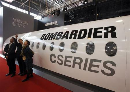 Visitors chat in front of a mock cabin of a Bombardier business jet on the first day of the China International Aviation & Aerospace Exhibition in the southern Chinese city of Zhuhai November 13, 2012. REUTERS/Bobby Yip/Files