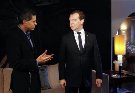 Russian Prime Minister Dmitry Medvedev (R) takes part in an interview with CNN news channel in Davos January 23, 2013. REUTERS/Dmitry Astakhov/RIA Novosti/Pool