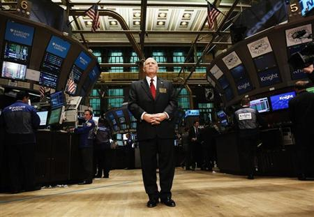 General Motors CEO Dan Akerson stands on the floor of the New York Stock Exchange during an interview November 18, 2010. REUTERS/Shannon Stapleton