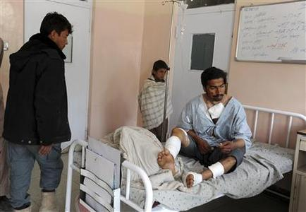 A wounded Afghan policeman receives treatment at a hospital in Kandahar January 27, 2013. REUTERS/ Ahmad Nadeem