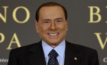 Former Italian Prime Minister Silvio Berlusconi smiles as he arrives to attend the book launch of his friend, TV presenter Bruno Vespa, in Rome December 12, 2012. REUTERS/Tony Gentile