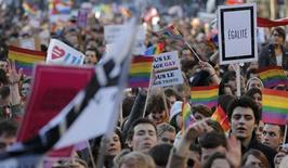 Demonstrators march through the streets of Paris in support of the French government's draft law to legalise marriage and adoption for same-sex couples, January 27, 2013. REUTERS/Christian Hartmann