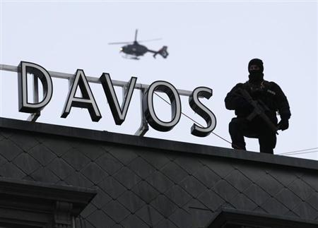 A member from Switzerland's special forces keeps watch on the roof of the Hotel Seehof during the annual meeting of the World Economic Forum (WEF) in Davos January 25, 2013. REUTERS/Denis Balibouse