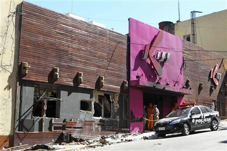 An exterior view of Boate Kiss nightclub is seen after a fire occurred, in the southern city of Santa Maria, 187 miles (301 km) west of the state capital of Porto Alegre, January 27, 2013. A fire in a nightclub killed at least 245 people in southern Brazil on Sunday when a band's pyrotechnics show set the building ablaze and fleeing patrons were unable to find the emergency exits in the ensuing panic, officials said. The blaze in the southern city of Santa Maria was started when a band member or someone from its production team ignited a flare, which then set fire to the ceiling, said Luiza Sousa, a civil police official. The fire spread ''in seconds,'' she said. An estimated 500 people were in the Boate Kiss nightclub when the fire broke out early on Sunday, and many were unable to find the exits as dark smoke quickly filled the room. At least one exit was locked, trapping hundreds inside to die, many from asphyxiation as they inhaled smoke, police said. REUTERS/Edison Vara
