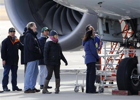 U.S. National Transportation Safety Board (NTSB) inspection charge Lorenda Ward (C), Federal Aviation Administration (FAA) technical advisor Eric West (2nd L), unidentified Boein Co. official (R) and members of the Japan Transport Safety Board (JTSB) inspect All Nippon Airways' (ANA) Boeing Co's 787 Dreamliner plane, which made an emergency landing on Wednesday, at Takamatsu airport in Takamatsu, western Japan January 18, 2013. REUTERS/Issei Kato